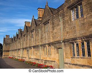 The Almshouses built out of Cotswold stone with stone tiles...
