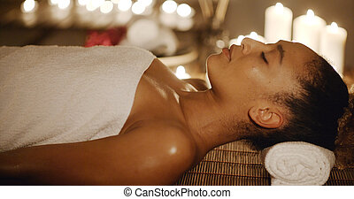 Woman Relaxing In A Spa Situation - Portrait of young...
