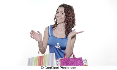 Young woman holding gift bags - 4k -Young attractive woman...