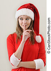 modesty girl weared in santa showing the silence sing...