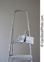 ladder and putty knife - construction site including ladder...