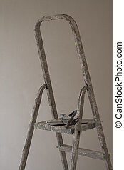 ladder and putty knife - construction site including ladder,...