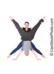 People with arms and legs spread - Two people standing with...