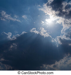 sunbeam through the clouds of sunlight in blue sky background