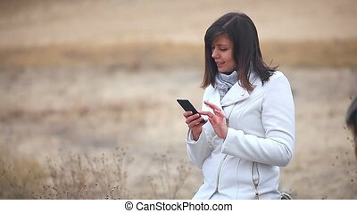Woman girl searching the internet smart phone social media...
