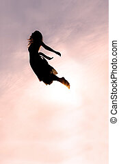 Silhouette of Woman Falling through Sky - Silhouette of a...