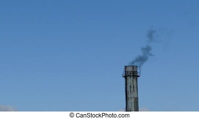 plant pipe black smoke against the blue sky environmental...