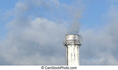 plant white pipe smoke black against blue sky environmental...