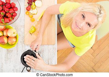 Mature woman blending a smoothie - A blond mature woman...