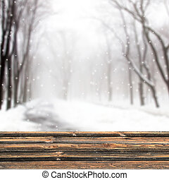 Winter forest background and shabby table