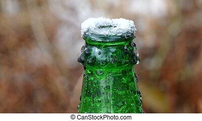 beer frozen bottle neck on top of ice - beer frozen bottle...