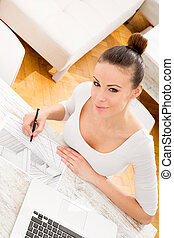 Woman drawing a blueprint
