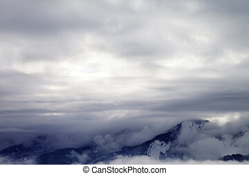 Winter mountains covered with clouds in morning