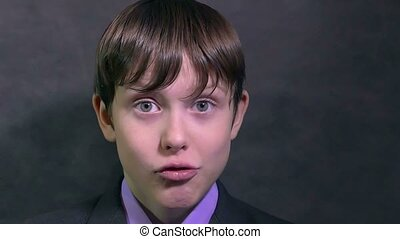 businessman boy teen makes faces faces emotions mug slow...