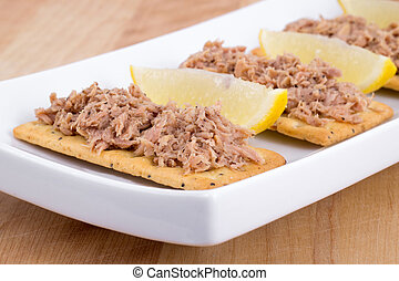Tuna meat on crackers canape - Tuna meat on crackers as...
