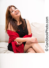 Beautiful mature woman on the sofa at home - A beautiful...
