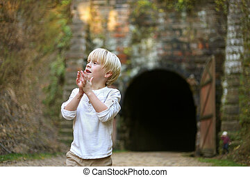 Young Child Exploring Outside at Old Rail Tunnel Trail - A...