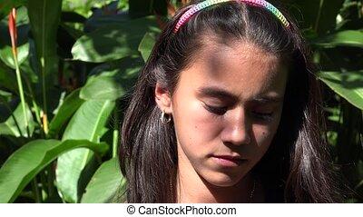 Solemn Teen Girl
