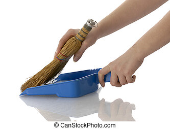 hands sweeping up - hands holding broom and dust pan...