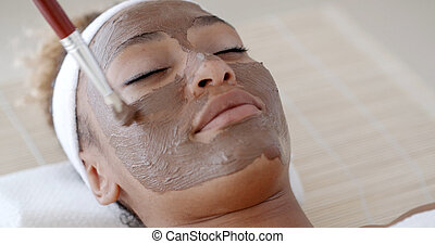 Impose Cosmetic Mask - Woman with clay facial mask in beauty...