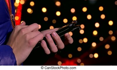 woman hands holding a smartphone phone Internet search bokeh...