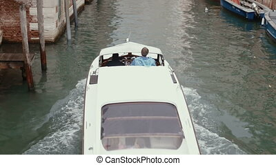 VENICE, ITALY - Sep 2013: Boat floats on the channel on 25th...
