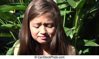 Crying Female Child on Sunny Day