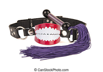 Chattering teeth ball gag and whip
