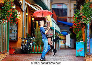 couple in love having fun under the rain