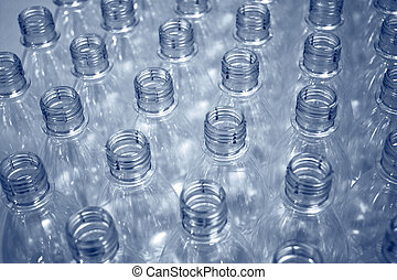 empty plastic bottles on a production line...