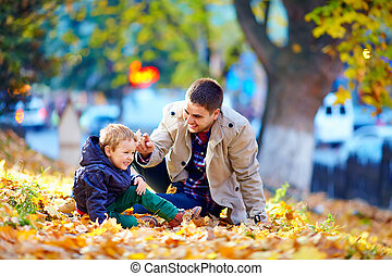 laughing family having fun in autumn park