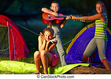 teenage kids having fun in summer camp