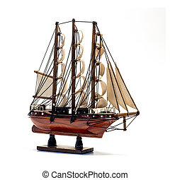 Model of the wooden antique schooner isolated on white...