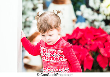 Toddler - Cute toddler girl playing in Santas house