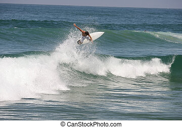 surfing wave - good surfer riding a wave