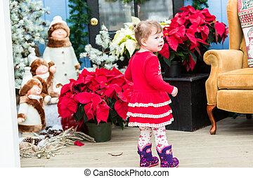Toddler - Cute toddler girl playing in Santa's house.