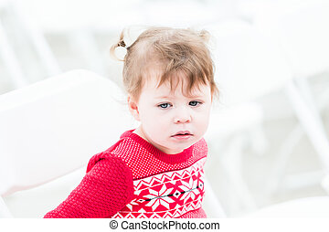 Toddler - Cute toddler girl playing on white chairs