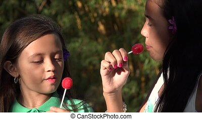 Girls Eating Lollipop Candy