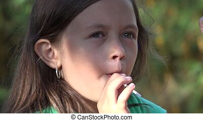 Girl Eating Lollipop Candy