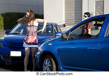 car accident - people in a car accident situation at day...