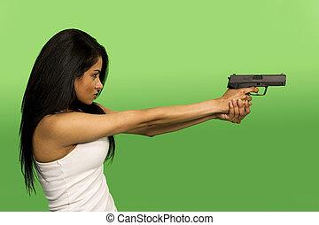 holding a gun - woman holding a gun over green screen