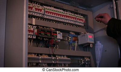 Man is in electrical energy distribution substation - Man is...