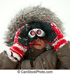 Kid with binocular - Young boy wearing winter jacket with...