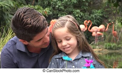 Father and Daughter with Flowers