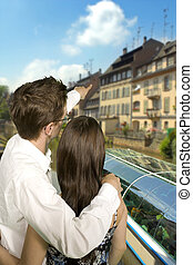 barge on canal - young couple looking at barge on canal in...