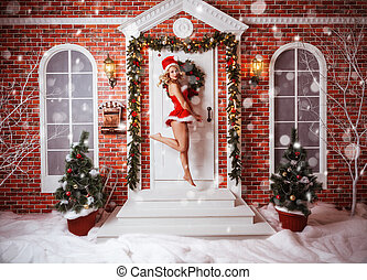 Beautiful attractive woman in Santa Claus clothes outdoor