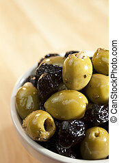 A Bowl of Stuffed Green and Black Olives