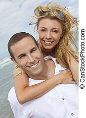 Man and Woman Couple In Romantic Embrace On Beach