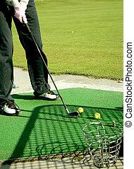 A golfer playing golf