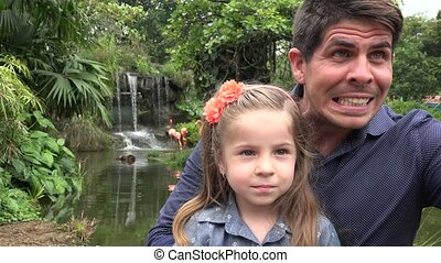 Father and Daughter at Zoo